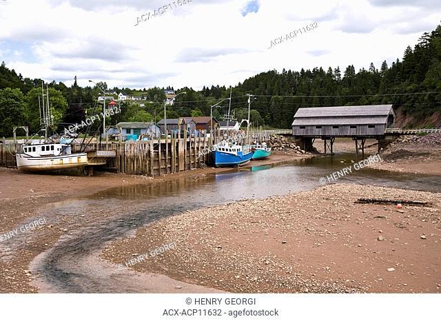 St Martin's wharf at low tide, New Brunswick, Canada