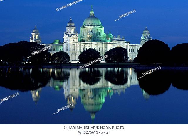 Night view of Victoria Memorial monument dome with moving angel statue , Calcutta now Kolkata , West Bengal , India