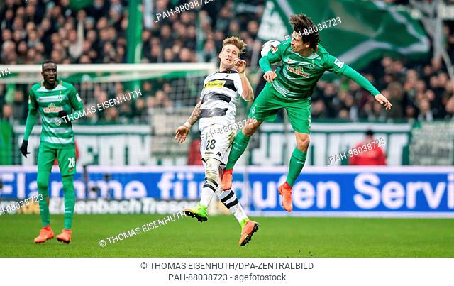 Moenchengladbach's Andre Hahn plays against Bremen's Thomas Delaney (R) during the German Bundesliga soccer match between SV Werder Bremen and Borussia...