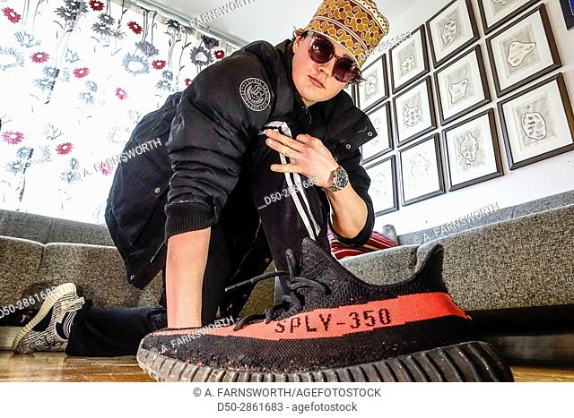 STOCKHOLM, SWEDEN 16 year old hamming it up with street cred and countefeit sneakers from China