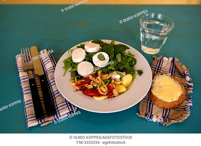 Tilburg, Netherlands. A dish with a Healthy salade and bread on a dining room table