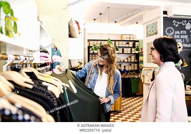 Young women shopping at boutique