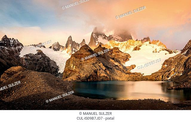 Storm cloud over Fitz Roy mountain range and Laguna de los Tres in Los Glaciares National Park, Patagonia, Argentina
