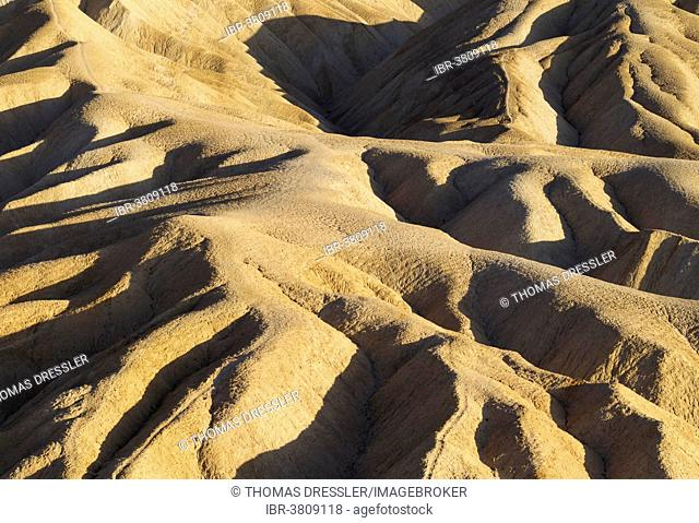 Eroded badlands in the Gower Gulch seen from Zabriskie Point in the evening light, Death Valley National Park, California, USA