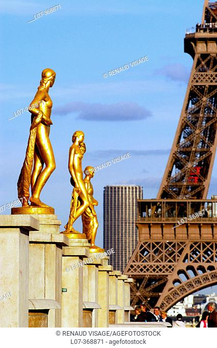 Golden statues of the Palais of Chaillot after the 2004 renovation and the Eiffel Tower. Paris. France
