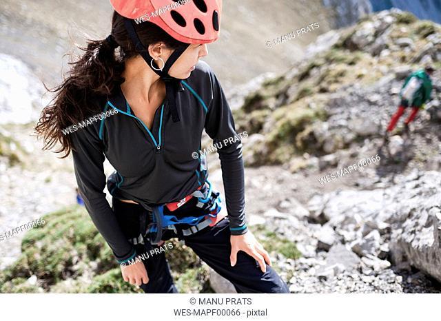 Spain, Picos de Europa, climber turning round