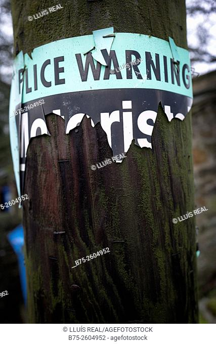 Police Warning sign stuck on a electrical pole. Grassington, Skipton, North Yorkshire, Yorkshire Dales, England, UK, Europe