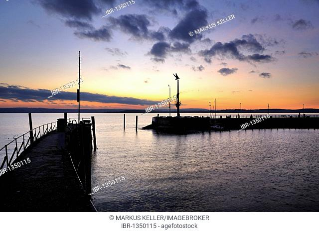 View from the pier over the harbour and the guidance statue after sunset, Meersburg, Lake Constance district, Baden-Wuerttemberg, Germany, Europe