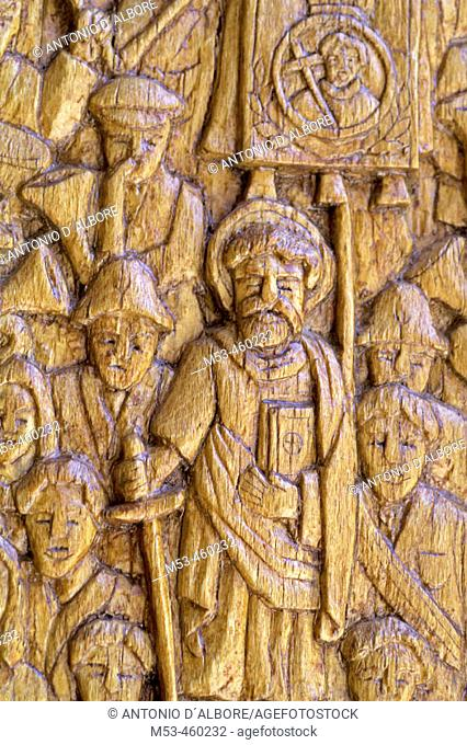 Religious scene carved in the wood of the doors of the Church of San Pietro e Paolo, Pescasseroli. L'Aquila, Abruzzo, Italy