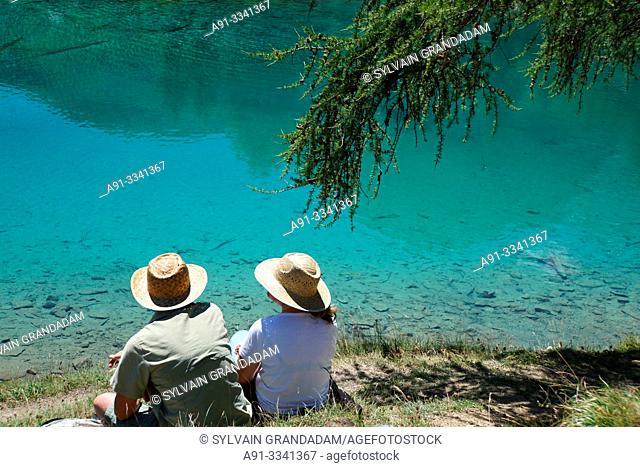 "Switzerland, Valais (Wallis), Val d'Herens, Village of Evolene/, the blue lake of ""La Couille"" in summer/ Suisse, Valais (Wallis), Val d'Herens"