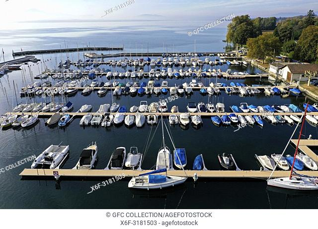 Boats moored at berths in a yacht harbour at the Lake Geneva, Rolle, Vaud, Switzerland