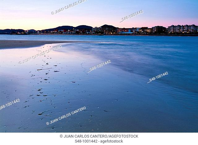 Sunset on the beach at Laredo, in the background Santoña. Cantabria. Spain