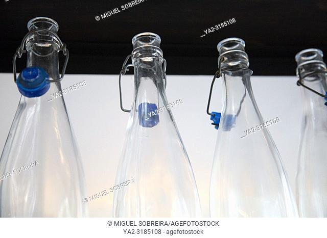 Empty Glass Water Bottles in Restaurant
