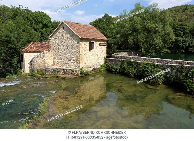 View of old mill and river, Krka River, Krka N.P., Dalmatia, Croatia, July