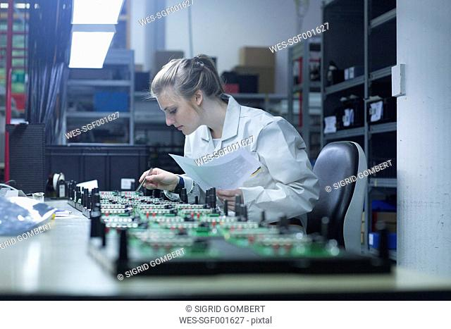 Technician working on circuit boards