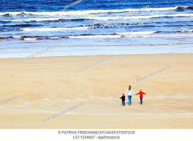 family on sandy beach, Sutherland, Scotland