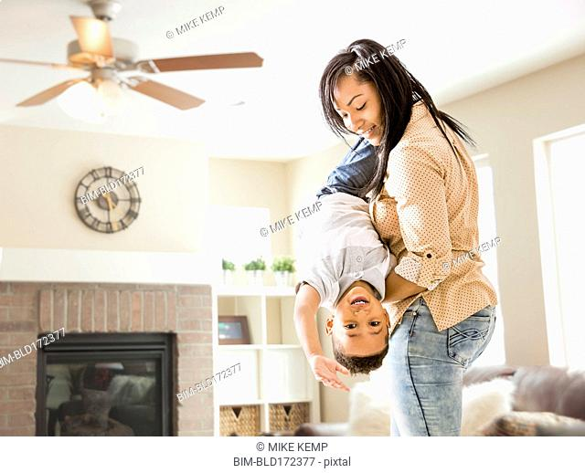 Mixed race mother and son playing in living room