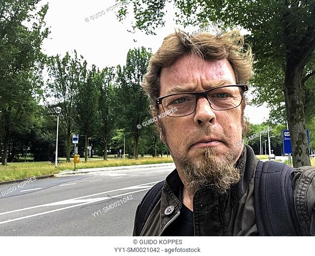 Tilburg, Netherlands. Selfie portrait of a mature adult caucasian male wearing glasses and a beard