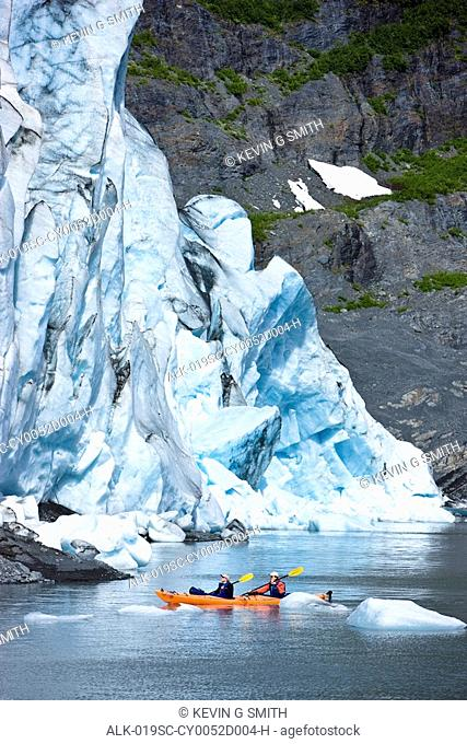 Couple kayaking in Shoup Bay with Shoup Glacier in the background, Prince William Sound, Southcentral Alaska