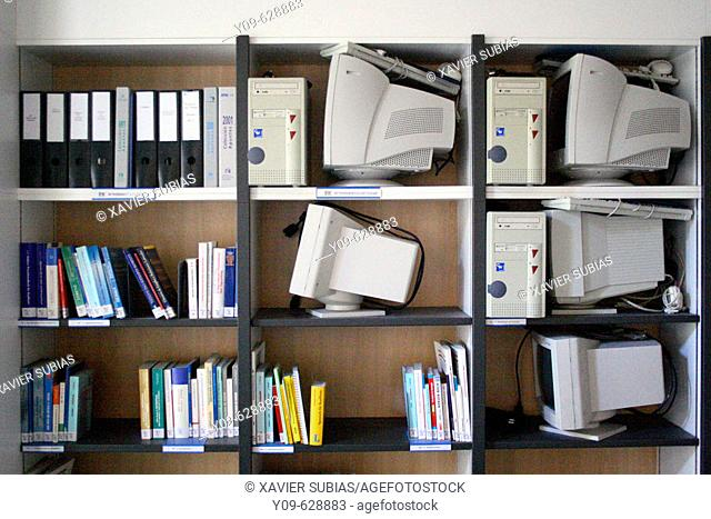Shelf with books and computers