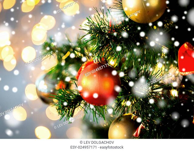 holidays, new year, decor and celebration concept - close up of christmas tree decorated with balls