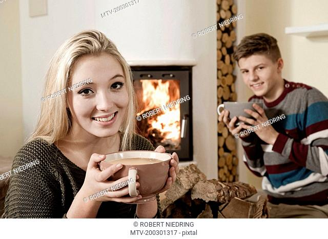 Young teenage couple first date log fire romantic