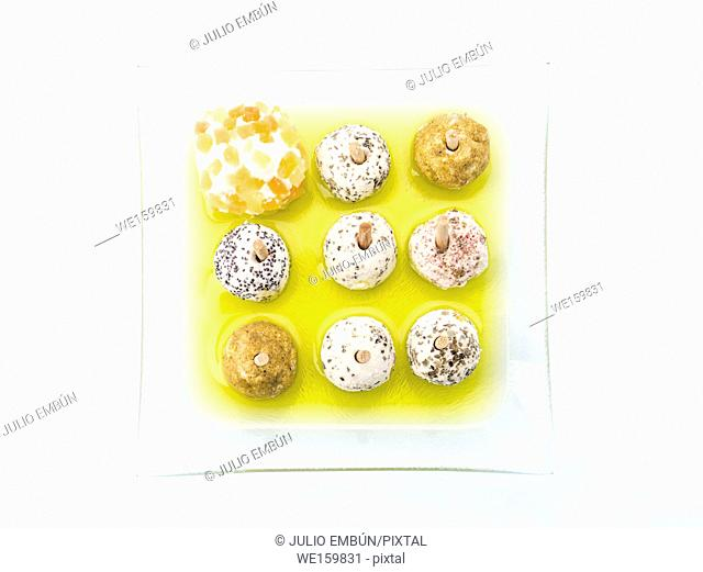 cheese balls with spices in olive oil