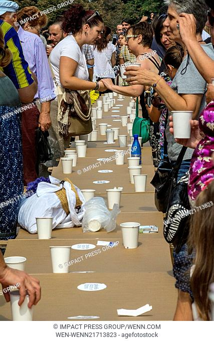 Bulgarians drink wine and wear special costumes at a 500-meter-long table in the downtown Plovdiv, to celebrate the city's selection by an international jury as...