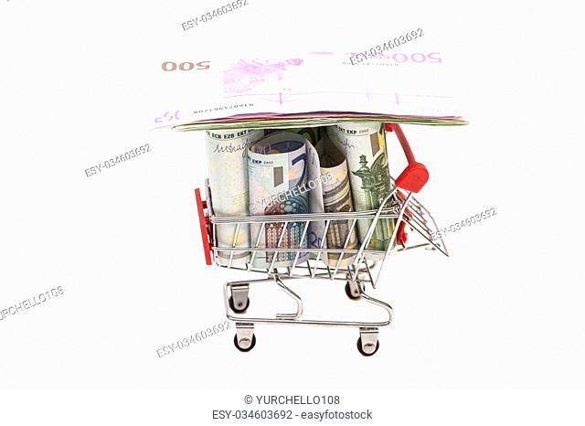 shopping cart full of euro banknotes isolated