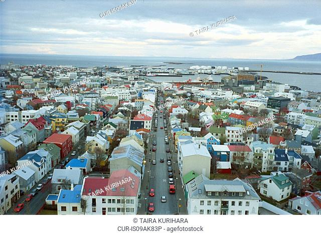 Elevated view of Reykjavik cityscape with distant coast, Iceland
