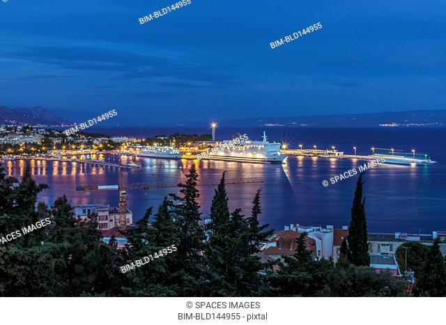 Aerial view of illuminated dock and cityscape of coastal town, Split, Split, Croatia