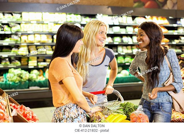 Women shopping together in grocery store
