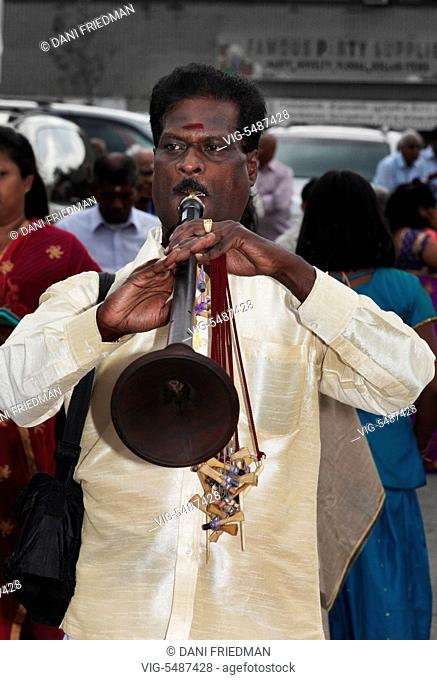 CANADA, SCARBOROUGH, 11.09.2015, A Tamil Hindu musician playing Naathaswaram as he leads the procession during the Chariot festival of Kandaswamy (Lord Murugan)...