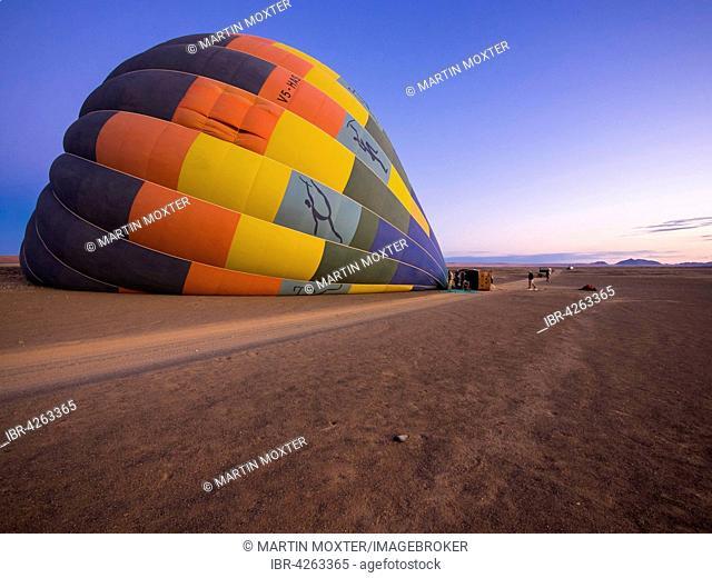 Hot air balloon being filled with air, Kulala Wilderness Reserve, Namib Desert, Tsaris Mountains, Hardap Region, Namibia