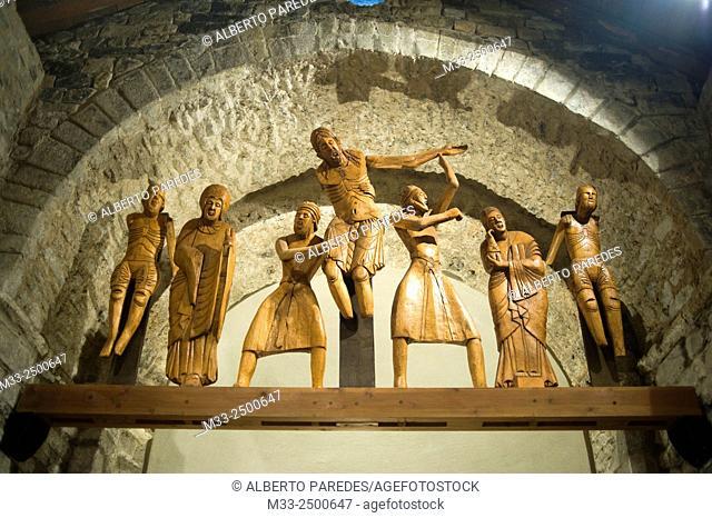 Santa Eulalia romanesque church in Erill la Vall. Vall de Boi, Lleida, Catalonia Spain. Descent from the Cross wooden sculptures