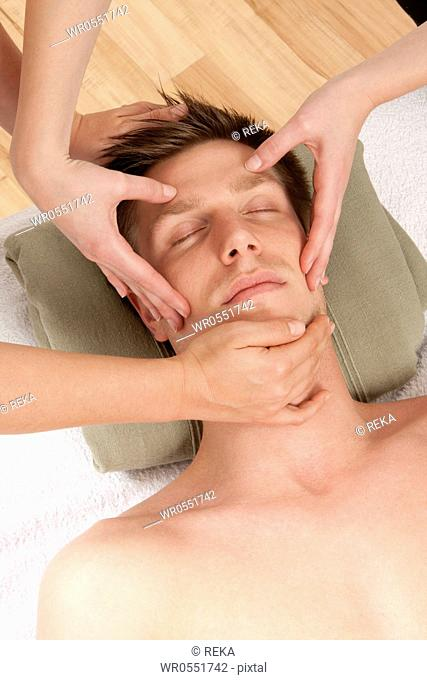 Young man relaxing during massage