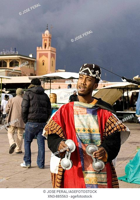 Man playing music at Djemaa el Fna square, the liveliest place night and day in Marrakech. Morocco