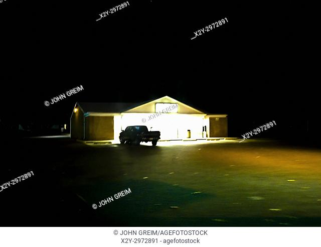 Pick-up parked in remote convenience store parking lot late at night, New Jersey, USA