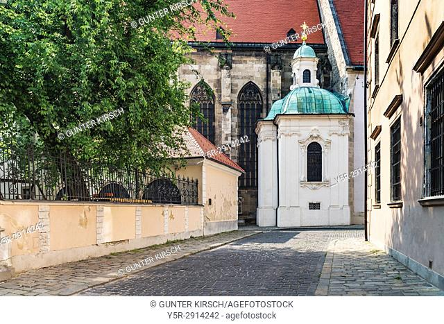 View from the Kapitulska Street to the outer chapel of the Cathedral of St. Martin. The Viennese sculptor Georg Raphael Donner has built the chapel from 1729 to...