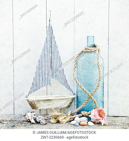 Sailing ship with bottle rope and sea shells