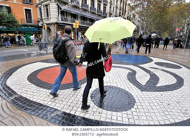 La Rambla, Pla de la Boqueria aka Pla de l'Ós with mosaic by Joan Miró on a rainy day, Barcelona, Catalonia, Spain