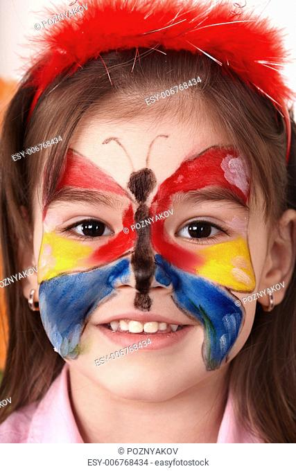 Little girl making face painting