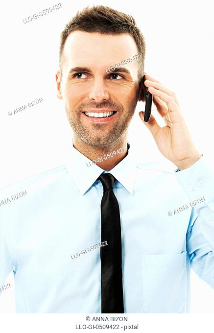 Handsome businessman talking on mobile phone Debica, Poland