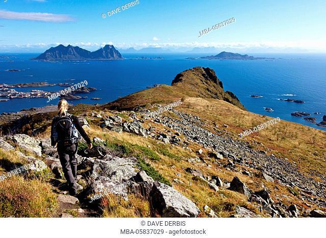 Young woman, walking, view, Tjeldbergtinden, Austvagoya, Lofoten, Norway, Europe