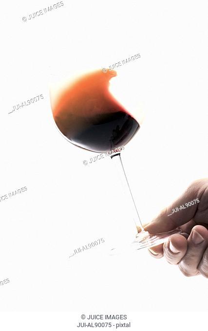 Man swirling wine in glass