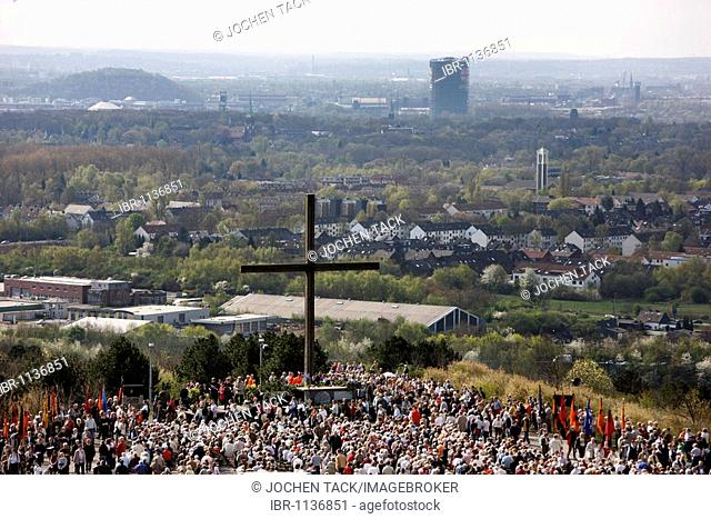 Way of the Cross procession on Good Friday with mining motifs on the slag heap Haniel, the Prosper-Haniel mine, the Oberhausen gasometer at back, Bottrop, Ruhr