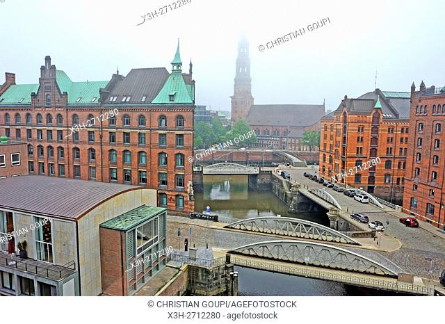 aerial view of the Kleines Fleet canal in the Speicherstadt (City of Warehouses) with St. Catherine's Church in the background, HafenCity quarter, Hamburg
