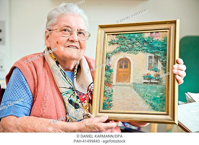 Frieda Pester holds a painting of her house in Rothenburg ob der Tauber, Germany, 12 July 2013. 28 years ago, Priest Jorge Mario Bergoglio lived in a small room...