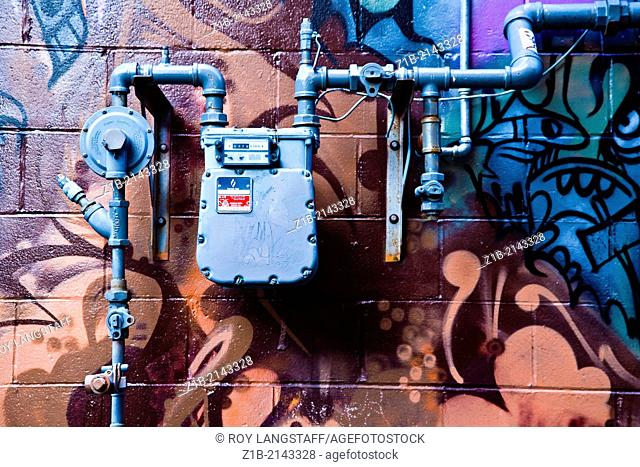 Abstract image of a gas installation on a painted wall