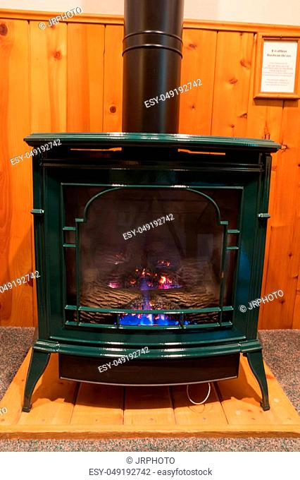 Bedroom heating from a propane fireplace made to look like an antique wood stove